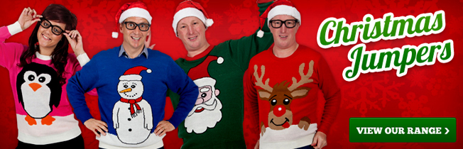 Geeky models wearing colourful Christmas jumpers